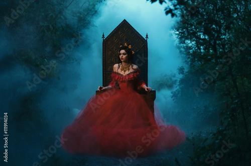 Fotografia dark evil queen sitting on a luxurious throne,dark boho,  Princess in red dress