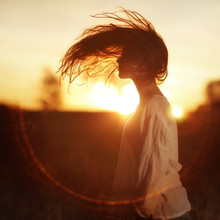 Girl With Long Hair At Sunset In The Field