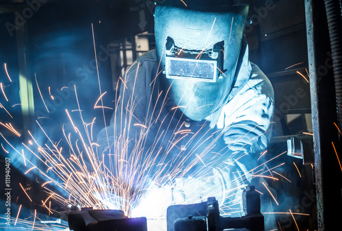 Fototapeta  Industrial steel welder in factory