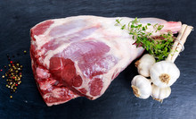 Raw Lamb Leg On Blue Stone Bac...