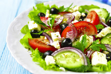 Traditional Greek Salad On A White Plate.