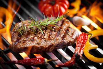 Panel Szklany Do gastronomii Steakfleisch auf dem Grill