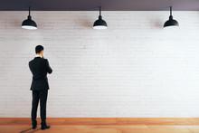 Thoughtful Man Looking At Wall