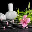 beautiful spa concept of pink hibiscus flower, bamboo, thai herb
