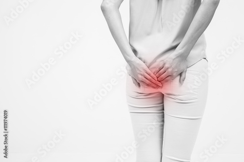 Woman has Diarrhea Holding her Butt: Isolated on White Backgroun Wallpaper Mural