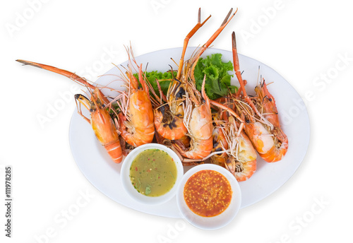 Poster  Grilled shrimps on a plate served with spicy sauce