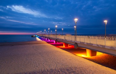 Fototapeta Molo Colorful lights on the pier in the evening, Kolobrzeg, Poland