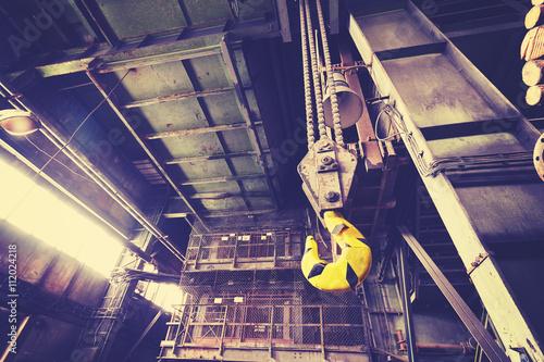 Staande foto Industrial geb. Vintage toned crane hook in old abandoned coal mine.