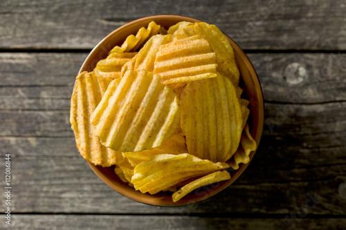 Fényképezés  Crinkle cut potato chips.