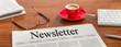 Leinwandbild Motiv Zeitung auf Schreibtisch - Newsletter