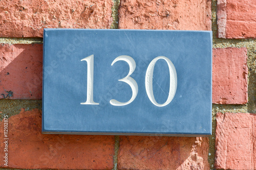Fotografia  House Number 130 sign
