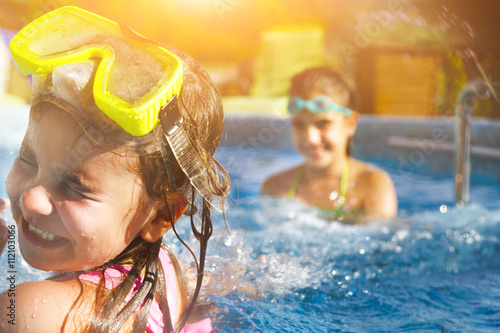 Photo  Children playing in pool. Two little girls having fun in the poo