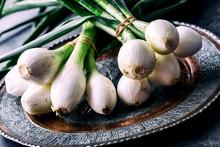 Onion. Fresh Onion. Fresh Green Onions. Young Onions On Plate.Healthy Fresh Vegetables.