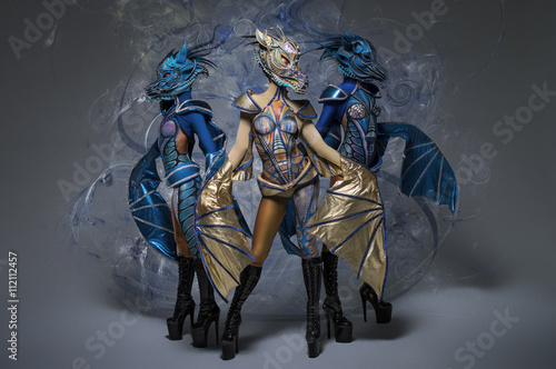 Staande foto Kinderkamer Women with beautiful dragons body-art, masks and wings
