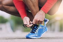 Runner Tying His Running Shoes...