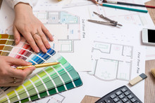 Architects Hands Working With Drawing Sketch Home, Color Sample And Other Working Tools