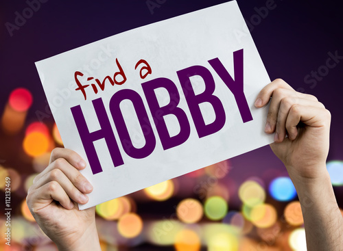 Photo  Find a Hobby placard with night lights on background