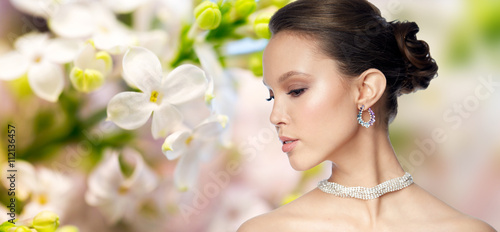 Fotomural close up of beautiful woman face with earring