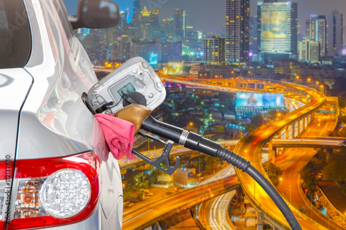 In de dag Illustratie Parijs Bronze car at gas station being filled with fuel and the Bangkok expressway and highway top view background, Transportation Concept