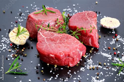 Fresh Raw Beef steak Mignon, with salt, peppercorns, thyme, garlic Canvas Print