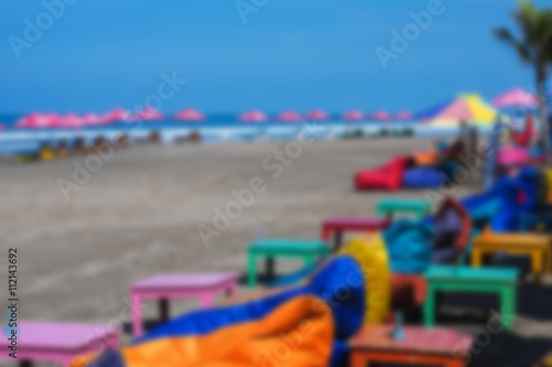 empty cushioned chairs and loungers on the beach