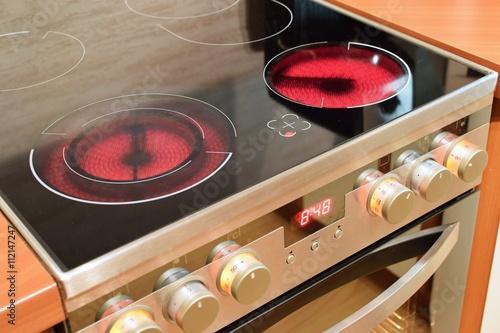 Electric ceramic stove inside the kitchen. Home interiors. Slika na platnu