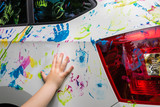 Little girl with colorful car