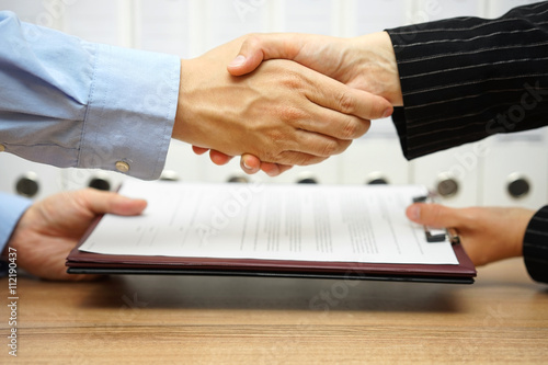 business partners are handshaking and exchanging contract after Canvas Print