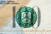 Close Up Of Number 100 With THE DEPARTMENT OF TREASURY Seal On US Dollar Bill