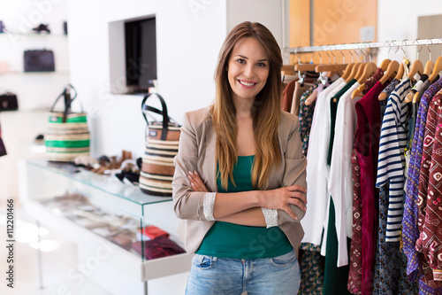 Obraz Sales assistant in clothing store  - fototapety do salonu