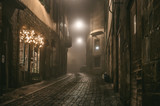 Old European narrow empty street of medieval town on a foggy evening. Taken in Bergamo, Citta Alta, Lombardia - 112207498