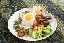 Nasi Goreng, Indonesian Fried Rice Plate, On The Batik Cloth