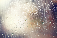 Water Drops.View Through The Windshield Of Strong Rainy Day ,Shallow Depth Of Field Composition