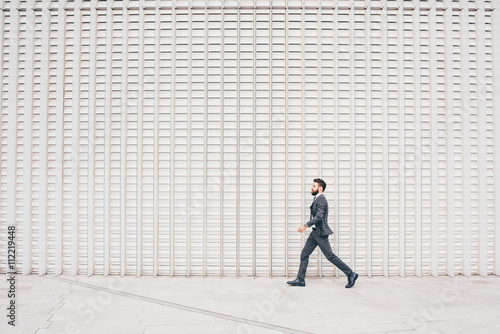Young contemporary business walking плакат