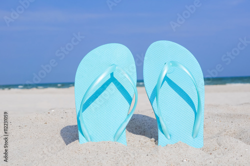 1999b4d7dd61 Flip Flops am Strand - Buy this stock photo and explore similar ...