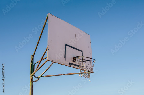 Fotografering  Basketball ring on blue sky