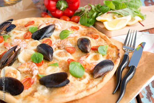 Photo  Seafood pizza, mussels, shrimps and squids