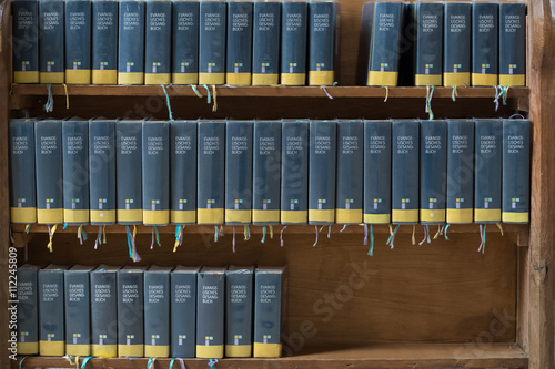 Wooden shelf with Protestant songbooks Fototapet