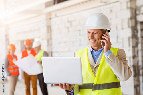 Business team. Building project Fototapet