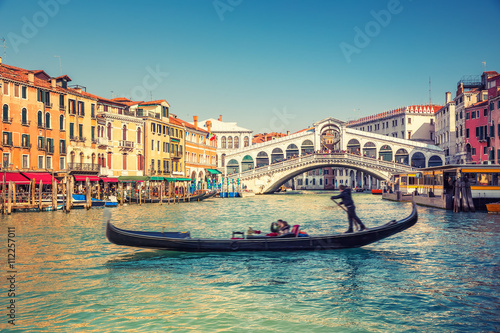 Fotografering  Gondola near Rialto Bridge in Venice, Italy