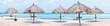 Beach umbrellas on Palm Beach in Aruba island in the Caribbean