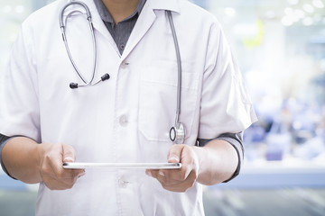 Doctor use a digital tablet for working.Healthcare and Medicine.