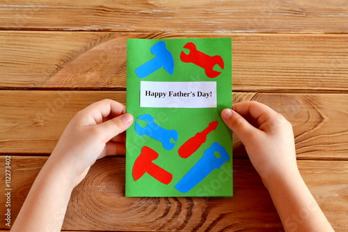 Child holds fathers day greeting card in his hands homemade fathers child holds fathers day greeting card in his hands homemade fathers day greeting card idea m4hsunfo
