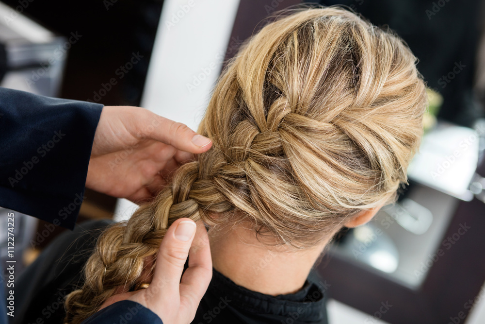 Fototapety, obrazy: Closeup Of Hairstylist's Hands Braiding Client's Hair