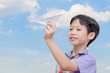 Young Asian boy playing with paper airplane
