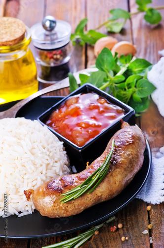 Deurstickers Klaar gerecht boiled rice with sausages