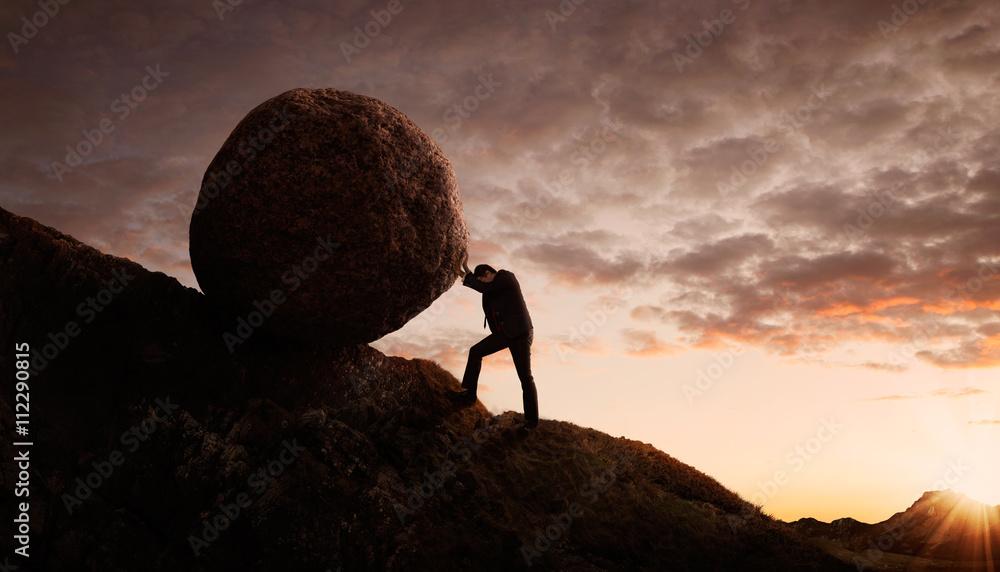 Fototapety, obrazy:  Young businessman pushing large stone uphill