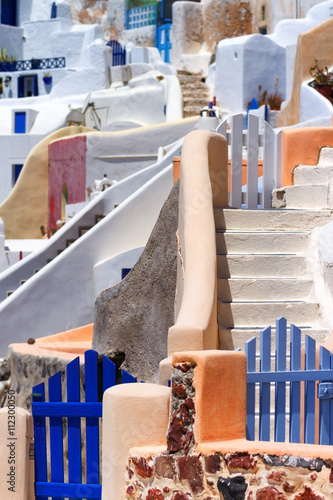 Fototapety, obrazy: Close up of the narrow streets, small doors and steep stairs of Oia town, Santorini, Greece. Vertical shot