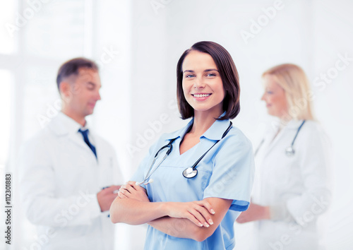 young female doctor with stethoscope Poster