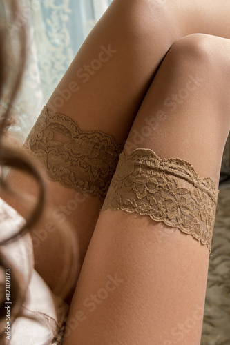 Photographie  Female legs in stockings